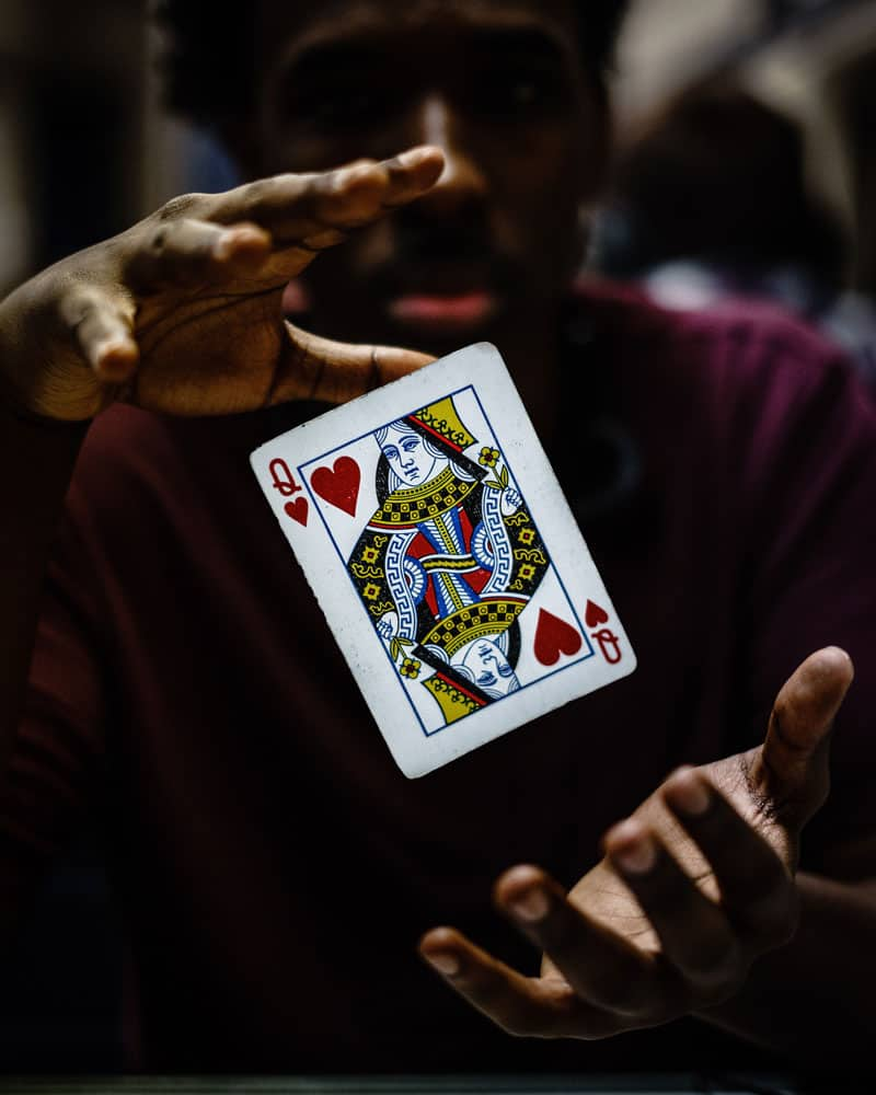 card floating between hands